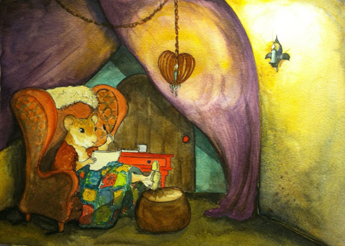 Ginger paints in her sketchbook while curled up in her nest